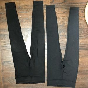 2 pairs of black Ivivva leggings